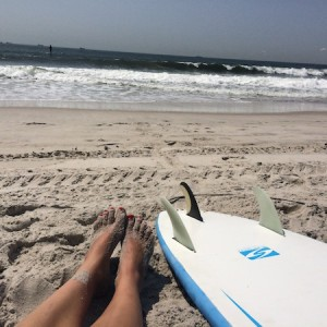 Post-surf sess toes in the sand in Long Beach